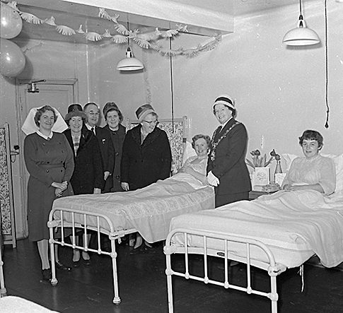 December 1960: The Mayor of Morley, Mrs Anne Clayton, and party visits new mums at Morley Hall maternity home