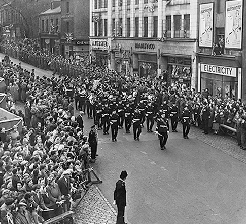 October 1954: The band of the Kings Own Light Infantry marches in Queen Street before the visit of the Queen and Prince Philip
